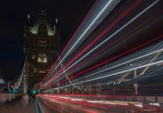Light trails on Tower bridge at night, London, England.  Royalty Free Stock Photo