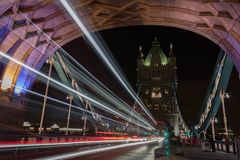 Light trails on Tower bridge at night, London, England.  Stock Images
