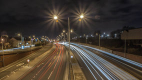 Light trails through a town Royalty Free Stock Image