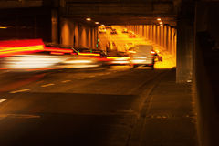 Light trails of traffic entering a tunnel Stock Photography