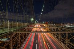 Light trails of traffic on a highway bridge royalty free stock photography