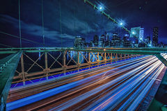 Light Trails from Traffic with Manhattan in the background Stock Images
