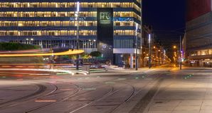 Light trails of a tram passing by stock images