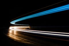 Light trails in tunnel. Art image. Long exposure photo taken in Royalty Free Stock Photo