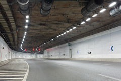 Light trails in tunnel. Car driving fast in tunnel Royalty Free Stock Photography