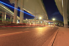 Light trails under city highway viaduct Royalty Free Stock Images