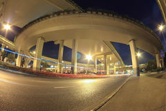 Light trails under city highway viaduct Stock Images