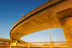 Light trails under highway bridge. Capturing the light trails under highway bridge that jumps across motorway royalty free stock photo
