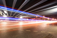 Light trails under the viaduct Stock Images