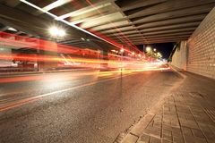 Light trails under the viaduct Royalty Free Stock Image