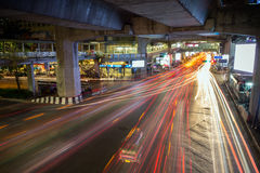 Light trails of vehicles under a bridge at night in Bangkok Royalty Free Stock Photography
