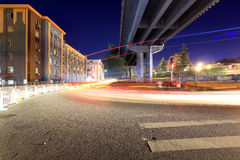 Light trails through the viaduct below Stock Photos