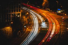 Light trails on the road at night. Light trails on the winding road at night Royalty Free Stock Images
