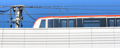 Light train running under blue sky. City railway and train running, shown as transportation and construction industrial concept Royalty Free Stock Images