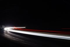 Light tralight trails in tunnel. Long exposure photo in a tunel Royalty Free Stock Photography