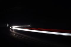 Light tralight trails in tunnel. Long exposure photo in a tunel Royalty Free Stock Image