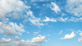 Light transparent clouds moving on the blue sky background. stock video footage