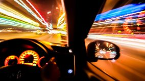 Light trial of the night road and front panel of the car royalty free stock photos