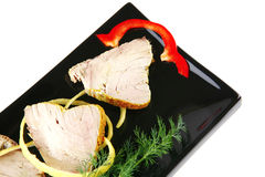 Light tuna slices served on plate Royalty Free Stock Images