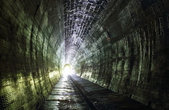 Light at the and of tunnel.Ancient cemetery around Royalty Free Stock Photo