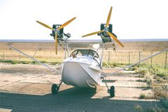 Light twin-engine amphibious aircraft at the airport. Front view stock photography