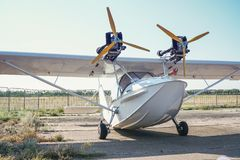 Light twin-engine amphibious aircraft at the airport. Ght twin-engine amphibious aircraft at the airport. Front view stock photo