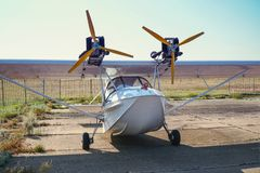 Light twin-engine amphibious aircraft at the airport. Front view royalty free stock images