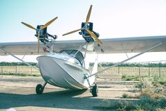 Light twin-engine amphibious aircraft at the airport. Front view royalty free stock photo