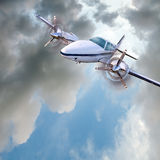 Light twin-engined piston aircraft in flight Stock Images
