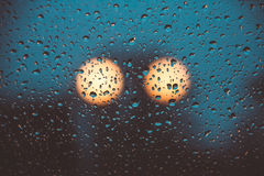 Light of two Lampposts behind the rainy window Royalty Free Stock Images
