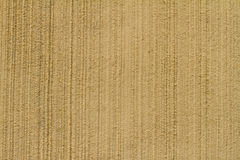 Light umber Stucco wall texture background. High res light umber Stucco wall texture background with vertical patterns Stock Image