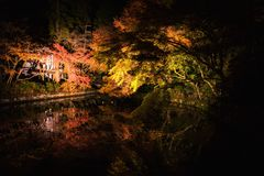 Light up autumn garden, Kiyomizu temple. Light up aun garden with reflection on water pond at Kiyomizu-dera temple, Kyoto, Japan. Famous landmark during fall in royalty free stock photography