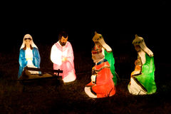 Light up Creche. Light up cheche in  a field with only the major figures Stock Image