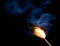 Light up a match. Match with flame and smoke at the moment of ignition Royalty Free Stock Photos
