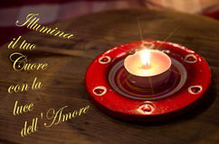 Light up your heart with the light of love. Valentine candle illuminates your heart and your love Stock Photo