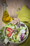Light vegetable salad. Vegetables for salad on a wooden table Royalty Free Stock Photo
