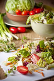 Light vegetable salad. Vegetables for salad on a wooden table Royalty Free Stock Images