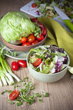 Light vegetable salad. Vegetables for salad on a wooden table Royalty Free Stock Photos