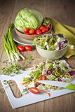 Light vegetable salad. Vegetables for salad on a wooden table Royalty Free Stock Photography