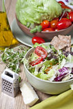 Light vegetable salad. Vegetables for salad on a wooden table Stock Photo
