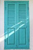 Light through the vintage blue door Stock Photos