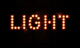 Light. Vintage style Light logo with light bulbs and sparks flying Royalty Free Stock Image