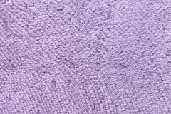 Light violet background from soft textile material. Fabric with natural texture. Royalty Free Stock Image
