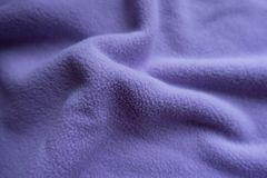 Light violet fleece in soft folds. Light violet fleece fabric in soft folds Stock Photos