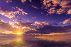 Light vivid sunset. With pretty clouds at sunset Stock Image