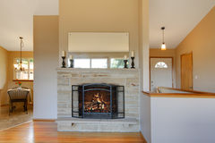 Light warm tones fireplace is a great idea for your living room Royalty Free Stock Photos