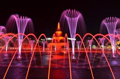 Light and water night show. Pink and red color