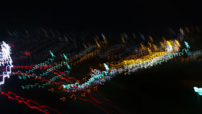 Light Waves. Colored lights seen at evening and during night with motion blur caused by bypassing cars / traffic and free hand hold camera, creating waves of Stock Photo