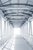Light from the way out of modern metal structure bridge. Or overpass walk way Stock Photography