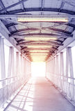 Light from the way out of modern metal structure bridge. Or overpass walk way Stock Photos